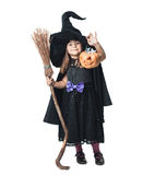 Little witch shows the collected candy Royalty Free Stock Images