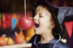 Little wizard eating apple Stock Images