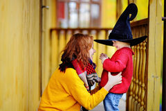 Little wizard and his young mother Stock Photos
