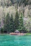 Little wodden house on the lake river, Gressoney Saint Jean Stock Images