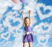 Little woman flying up to the sky Stock Image