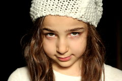 Little woman. Little girl with white wool hat stock images