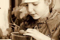 Little woman. Small woman with small plant in a pot Stock Images