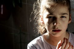 Little woman. Young girl with angry look royalty free stock images