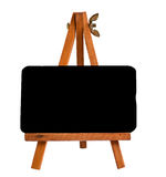 Little wood easel for artists with a black board Royalty Free Stock Photo