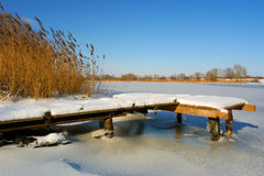 Little wooden berth in snow Stock Photos