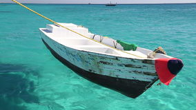 Little wooden boat floating in the Red sea, Egypt. Closeup of a little wooden boat floating in the Red sea, Egypt stock footage