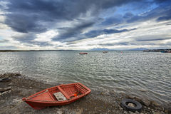 Little wooden boat, peaceful background. Stock Photo