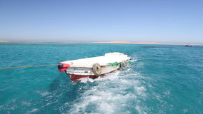 Little wooden boat in the Red sea, Egypt stock video