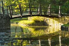 Little wooden bridge on first sunrays at morning Stock Image