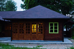 Little wooden cabin with a green window at blue hour in Belgrade Royalty Free Stock Photos
