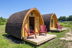 Little Wooden Cabins at a Camp Site Stock Images
