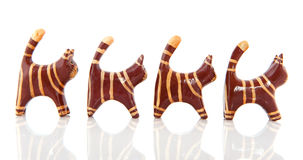 Little wooden cats Stock Images