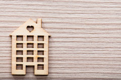 Little wooden house figure background or wallpaper Stock Photos