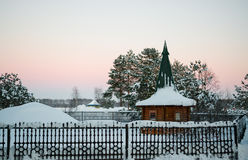 Little wooden house gazebo against the pink sky Stock Photography