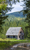 Little wooden house in mountain forest Stock Images