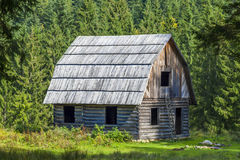 Little wooden house in mountain forest Royalty Free Stock Photo