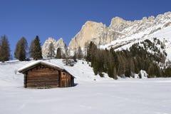 Wooden hut and Rosengarten, Costalunga pass Royalty Free Stock Image