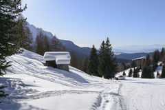 Huts on ski run side, Costalunga pass Stock Photography