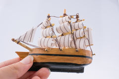 Little wooden model boat in hand Royalty Free Stock Image