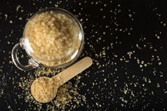 Little wooden spon filled with brown sugar Stock Photo
