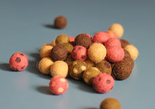 Little wool balls. Little colorful woolen ballson blue background Royalty Free Stock Images