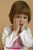 Little worries. Little cute child, looking worried and concerned Royalty Free Stock Photo