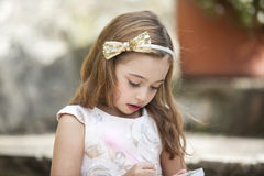 Little writer with her notebook and pencil Stock Images