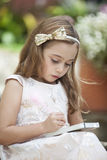 Little writer with her notebook and pencil Royalty Free Stock Photo