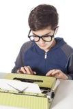 Little writer with vintage typewriter Stock Image