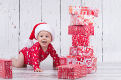 Little x-mas baby with gift tower Royalty Free Stock Photography