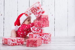 Little x-mas baby with gift tower Stock Image