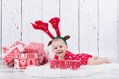 Little x-mas reindeer with gifts Stock Photo
