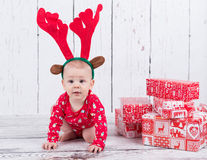 Little x-mas reindeer with gifts Royalty Free Stock Images