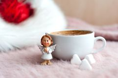 Xmas angel on the fluffy table. A little xmas angel  waiting for Christmas time to send good news Stock Photos