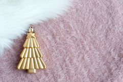 Xmas tree on the fluffy table. A little xmas tree  waiting for Christmas time to send good news Royalty Free Stock Image