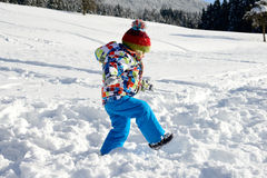 Little 3 year old child playing in the snow Royalty Free Stock Photos
