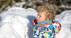 Little 3 year old child  in the snow Stock Photo
