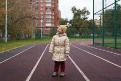 Little girl posing on a running track Royalty Free Stock Photo