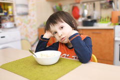 Little 4 years boy dont want to eat fruit salad Royalty Free Stock Images