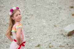 Little 7 years girl in pink dress outside Royalty Free Stock Image