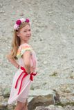 Little 7 years girl in pink dress outside Stock Image