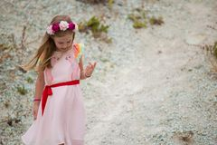 Little 7 years girl in pink dress outside Royalty Free Stock Images