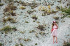 Little 7 years girl in pink dress outside Royalty Free Stock Photos
