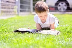 Little 7 years old boy browsing old photo album. Stock Images