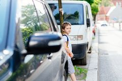 Little 7 years old boy during his road to school. royalty free stock photo