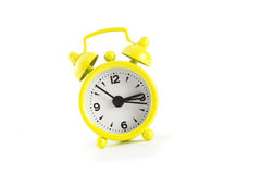 Little yellow alarm clock. Royalty Free Stock Images
