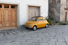 Little yellow compact  Italian car Royalty Free Stock Image