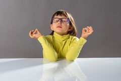 Zen little yoga child breathing, practicing yoga and closing eyes Stock Images