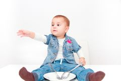 Little young baby girl want to eat Stock Image